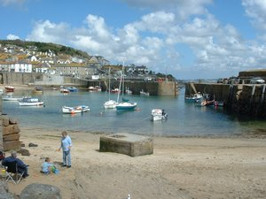Mousehole Harbour on the West Cornwall Coast Path Walking Holiday Footpath