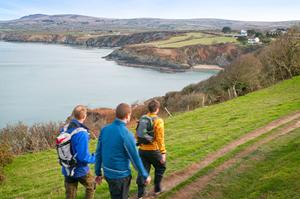 Pembrokeshire Coast Path Walkers at Dinas Head, Wales. Holidays and short breaks.