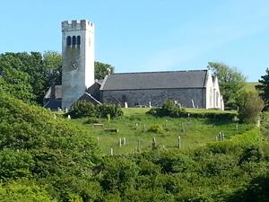 Manorbier Church, Pembrokeshire. Walking holidays UK. Wales Coastal Path.