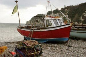 Fishing Boat at Beer Beach in Devon South West Coast Path Walk UK