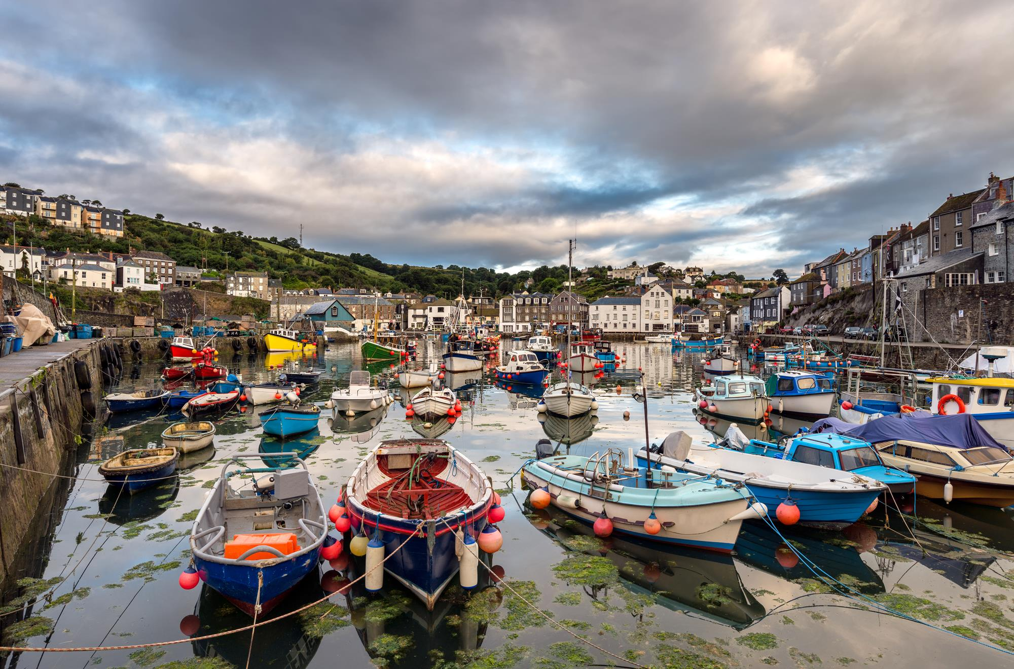 Boats in Mevagissey Harbour part of the coastal path in Cornwall