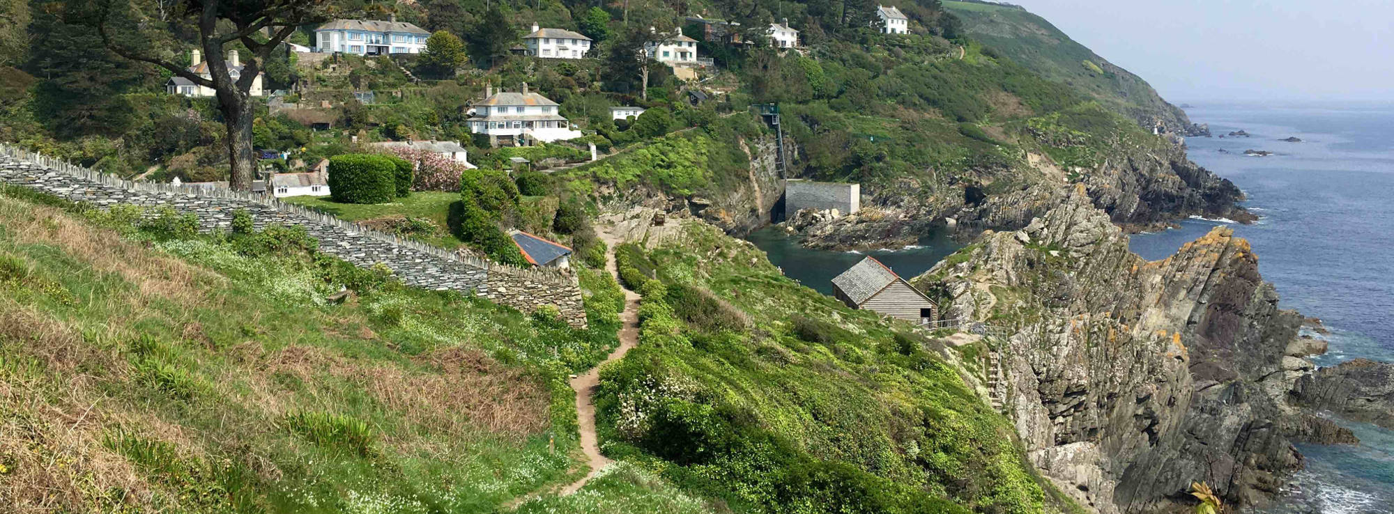 Walking coastal path into Polperro Cornwall