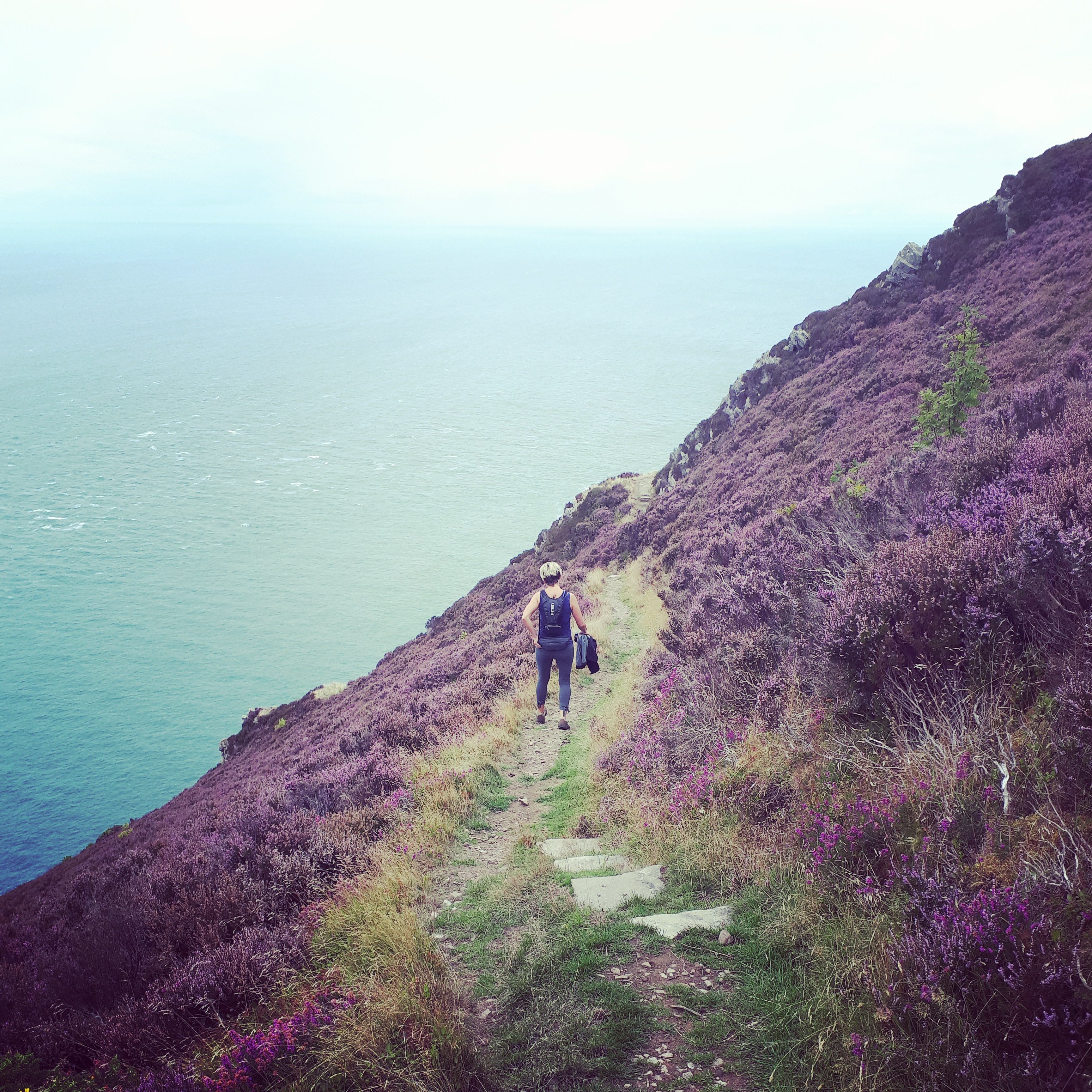 A walker on the South West Coast path near Lynmouth